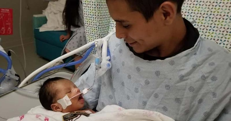 Baby cut out of mother's womb during 'womb raider' killing opens eyes for the first time while being held by dad