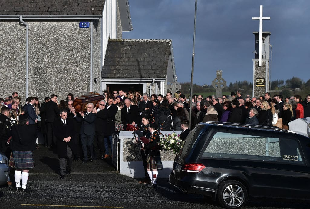 Family members carry the late Dolores O'Riordan from St Ailbe's Church, Ballybricken on January 23, 2018 in Limerick, Ireland. (Getty Images)