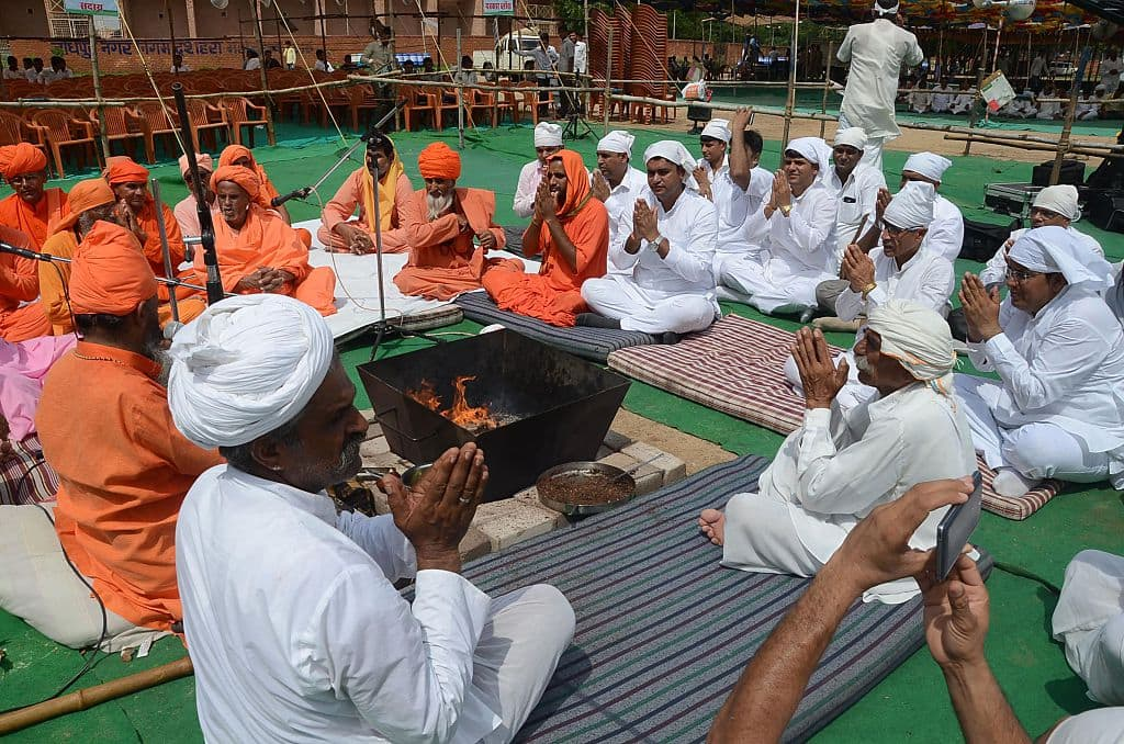 Members from the Bishnoi society offer prayers during 'Sadbuddhi Yagya' before taking part in a silent rally against The Rajasthan High Court's decision of the acquittal of Bollywood actor Salman Khan from the chinkara (Indian gazelle) poaching cases, in Jodhpur on August 12, 2016. More than ten thousand nembers of the Bishnoi society gathered for the rally. (SUNIL VERMA/AFP/Getty Images)