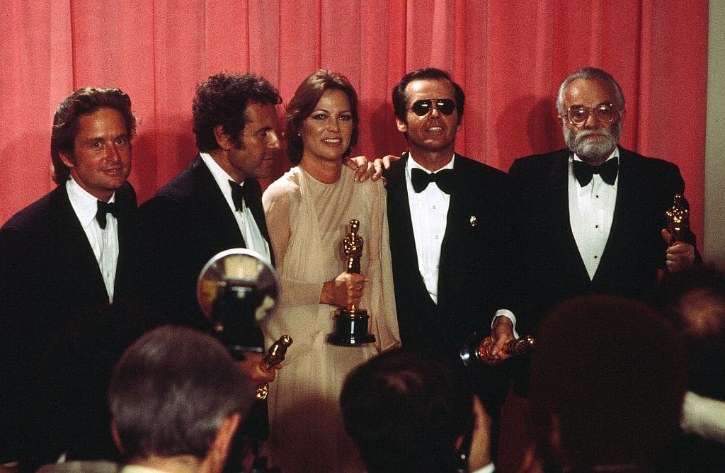 Producers Michael Douglas, Saul Zaentz, Director Milos Forman with Actor Jack Nicholson with actress Louise Fletcher pose backstage after winning 'Best Actor' , 'Best Actress' 'Best Picture' and 'Best Director' for 'One Flew Over the Cuckoo's Nest' during the 48th Academy Awards at Dorothy Chandler Pavilion in Los Angeles,California in 1976. (Photo by Michael Montfort/Michael Ochs Archives/Getty Images)