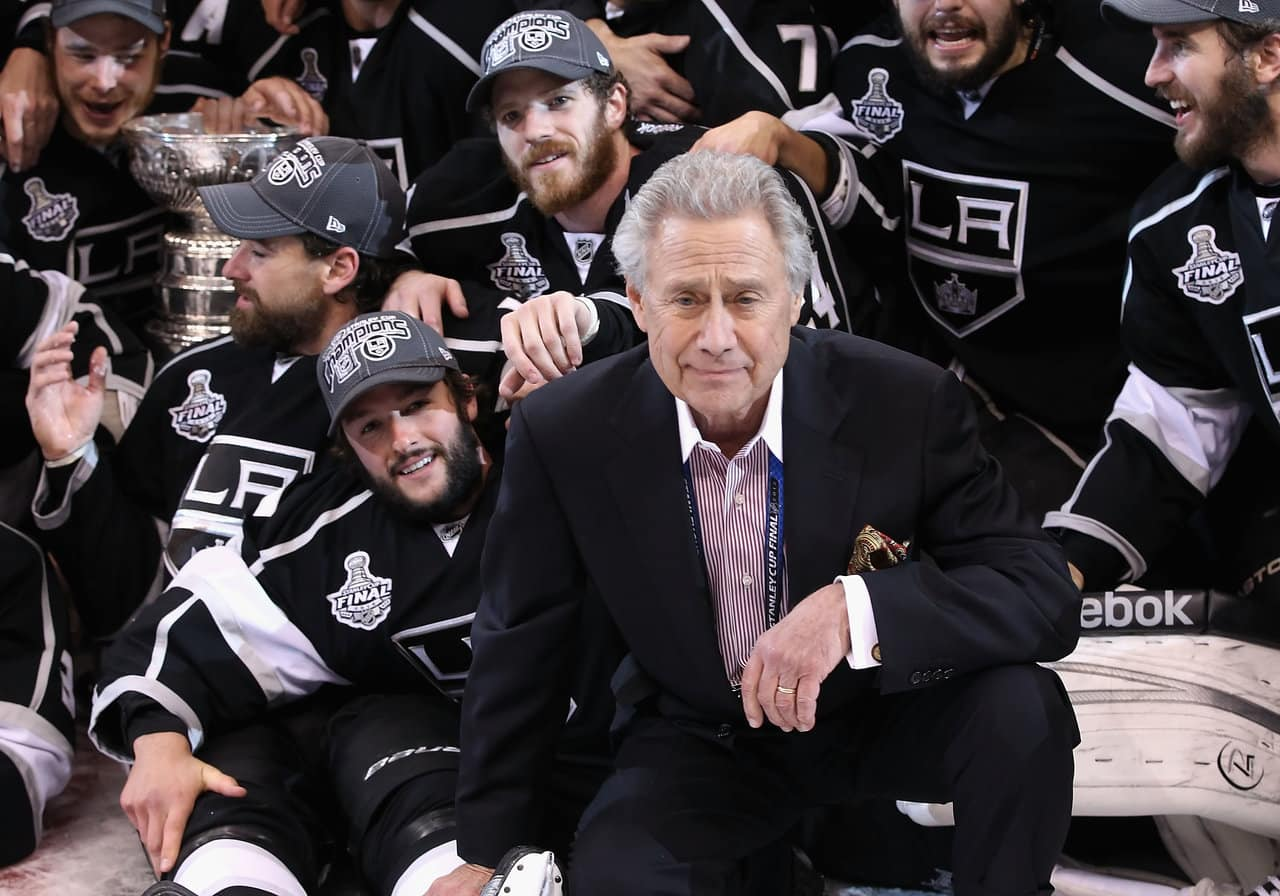 Owner of the Los Angeles Kings, Philip F. Anschutz poses with the team and the Stanley Cup after defeating the New Jersey Devils in Game Six of the 2012 Stanley Cup Finals at Staples Center on June 11, 2012 in Los Angeles, California. The Kings defeated the Devils 6-1 to win the series 4 games to 2. (Photo by Christian Petersen/Getty Images)