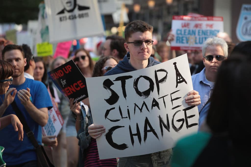 Demonstrators protest President Donald Trump's decision to exit the Paris climate change accord on June 2, 2017 in Chicago, Illinois. (Getty Images)