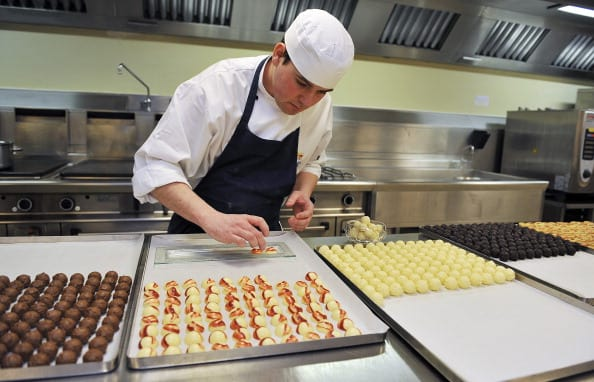 Royal Demi Chef De Partie, Shaun Mason, lays out trays of hand made sweets prepared in the kitchens, akin to that which is usually served at receptions held at Buckingham Palace on March 25, 2011 in London, England. Prince Prince William will marry his long term girlfriend Kate Middleton on April 29, 2011 at Westminster Abbey and it was reported that the couple had chosen two Wedding cakes for their big day - a 'multi-tiered traditional fruit case with a floral design and a chocolate biscuit cake.' (Photo by Nick Ansell - WPA Pool/Getty Images)
