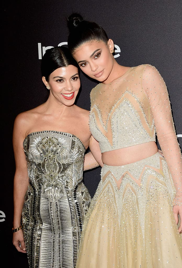 TV personalities Kourtney Kardashian (L) and Kylie Jenner attends InStyle and Warner Bros. 73rd Annual Golden Globe Awards Post-Party at The Beverly Hilton Hotel on January 10, 2016 in Beverly Hills, California. (Photo by Frazer Harrison/Getty Images)