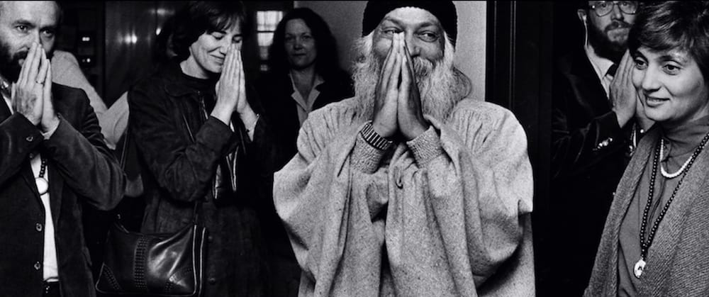 Osho Rajneesh (Centre) with Sheela (Right) and other followers of Rajneeshism. (Netflix)