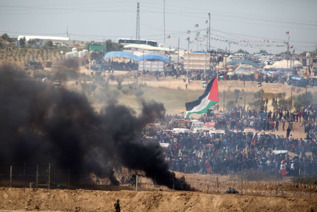 Palestinians protest on the Israel-Gaza border on April 13, 2018 in Netivot, Israel. Thousands of Gaza residents assembled on Friday at the border with Israel to stage another protest as part of their 'March of Return' for a third consecutive week. (Getty Images)