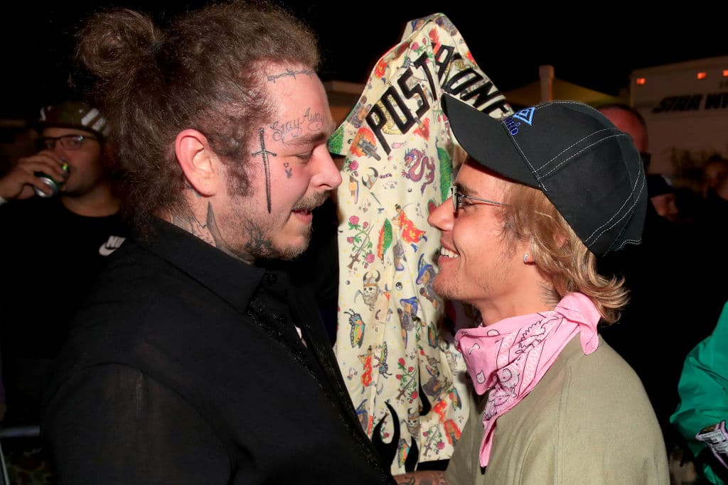 Post Malone and Justin Bieber speak backstage during 2018 Coachella Valley Music And Arts Festival Weekend 1 at the Empire Polo Field on April 14, 2018 in Indio, California. (Photo by Christopher Polk/Getty Images for Coachella)
