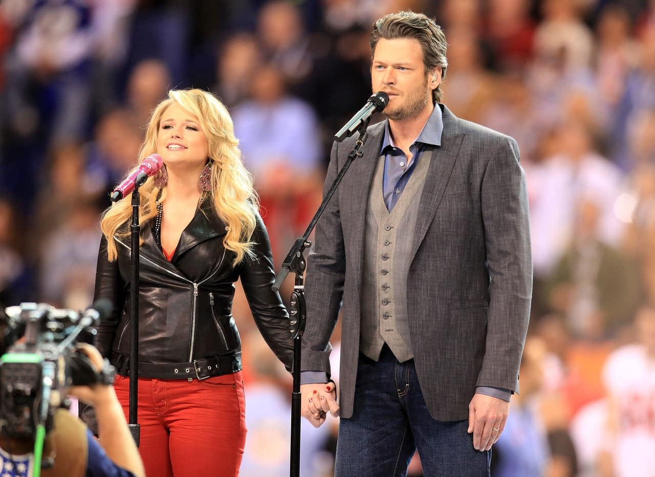 "Country singers Miranda Lambert and Blake Shelton perform ""America the Beautiful"" during the Bridgestone Super Bowl XLVI Pregame Show at Lucas Oil Stadium on February 5, 2012 in Indianapolis, Indiana. (Photo by Christopher Polk/Getty Images)"