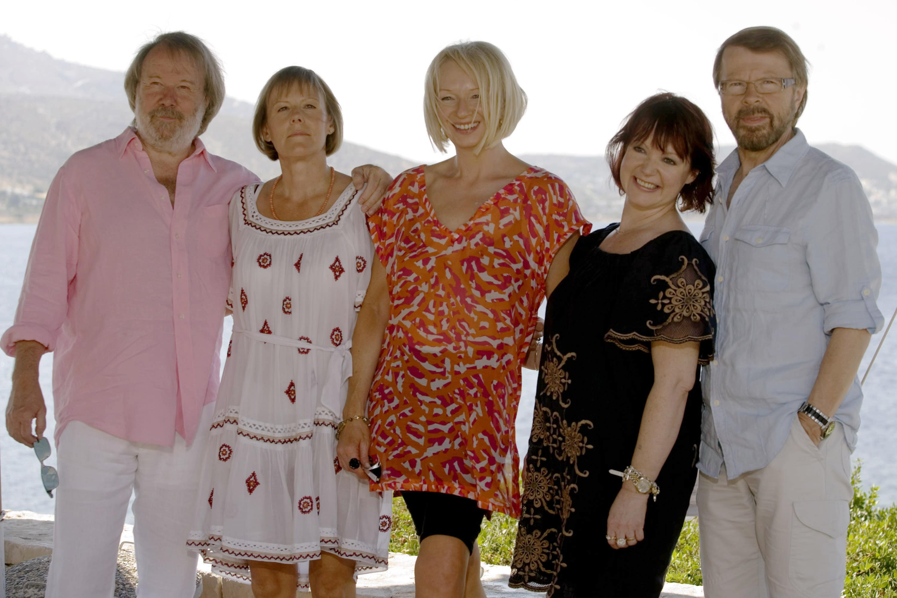 Benny Andersson, an unidentified woman, Judy Cramer, Mona Norkilt and Bjorn Ulvaeus of the Swedish music band Abba pose during a photocall for the movie 'Mamma Mia!' at the Lagonissi Grand Resort, on June 28, 2008 in Athens , Greece.(Photo by Milos Bicanski Getty Images)Caption