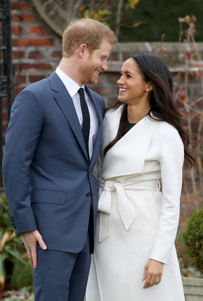 Prince Harry and Meghan Markle during an official photocall to announce their engagement at The Sunken Gardens at Kensington Palace on November 27, 2017 in London  (Photo by Chris Jackson/Chris Jackson/Getty Images)