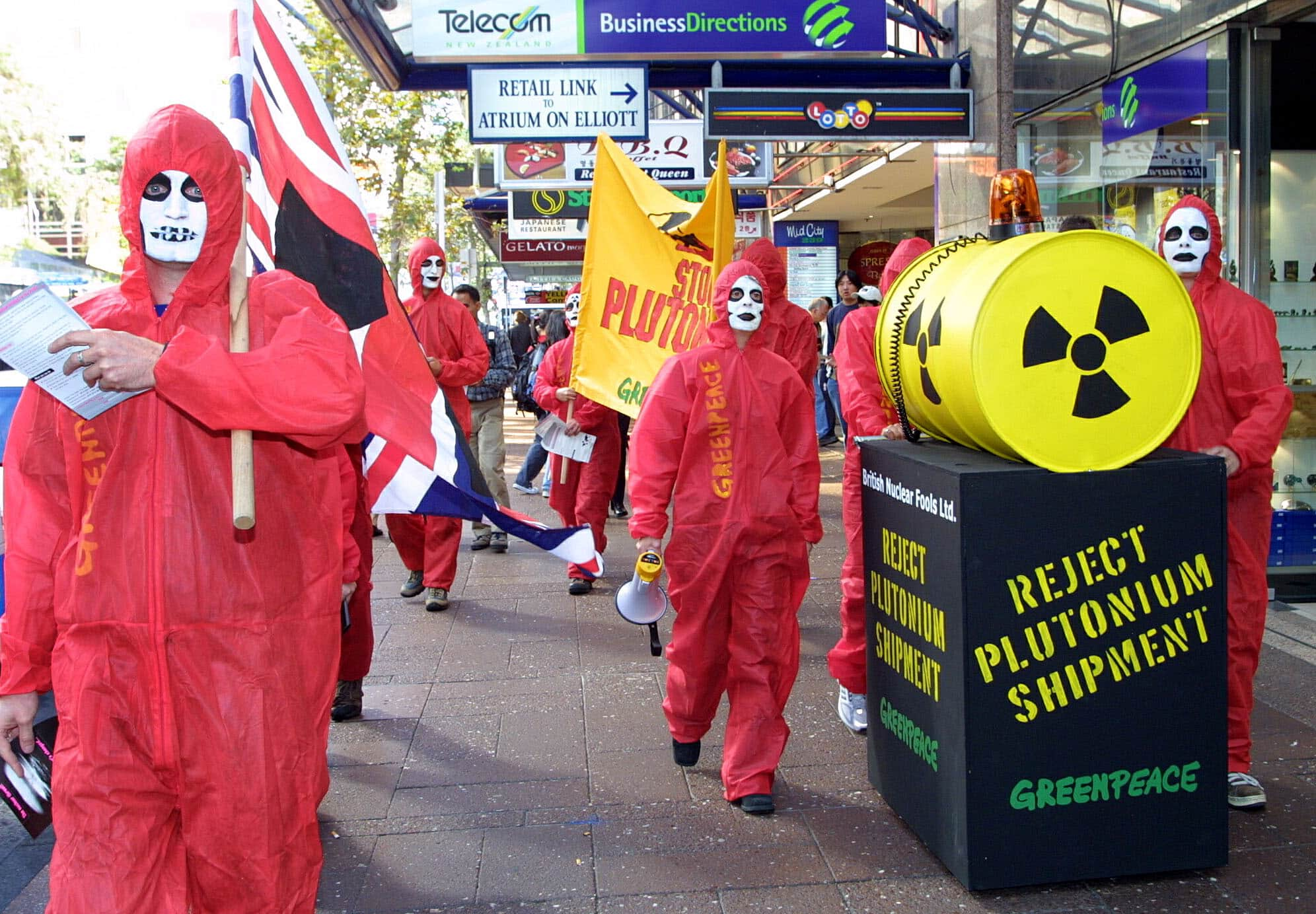 Greenpeace activists march down Queen Street on their way to the British Consul Generals offices to deliver a letter opposing the imminent shipment of plutonium from Japan to the UK via the Tasman Sea. (Getty Images)