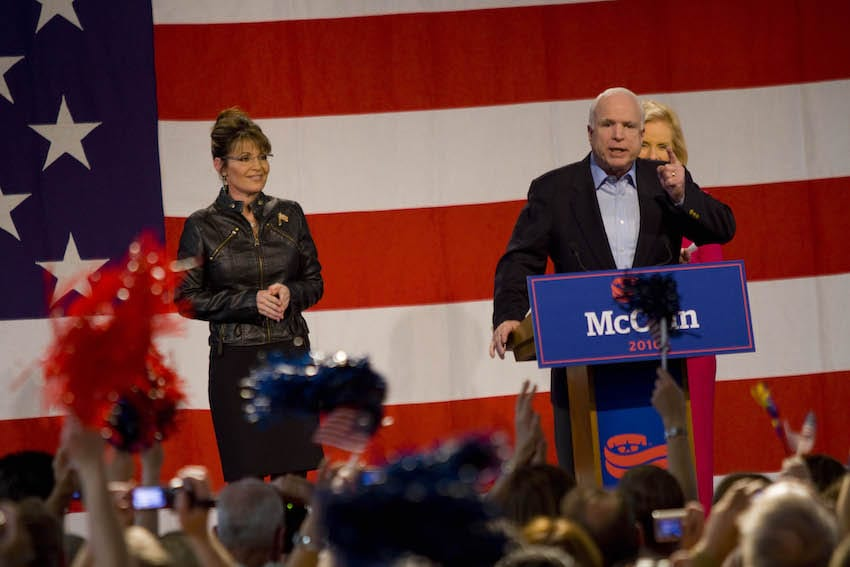 U.S. Sen. John McCain (R-AZ) speaks to supporters as former Alaska Gov. Sarah Palin (L), and his wife Cindy McCain, (R) look on during a campaign rally at Pima County Fairgrounds on March 26, 2010 in Tucson, Arizona. (Getty Images)