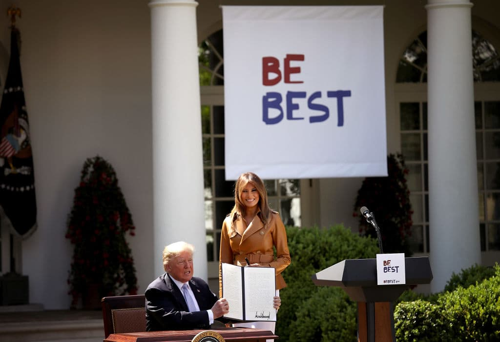 U.S. President Donald Trump holds up a proclamation for 'National Be Best Day' afer U.S. first lady Melania Trump spoke in the Rose Garden of the White House May 7, 2018 in Washington, DC. (Getty Images)