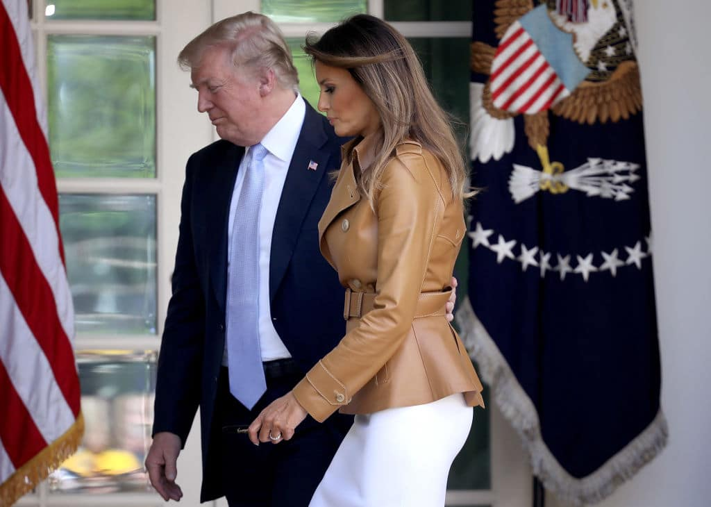 U.S. President Donald Trump escorts U.S. first lady Melania Trump after she spoke in the Rose Garden of the White House May 7, 2018 in Washington, DC. (Getty Images)