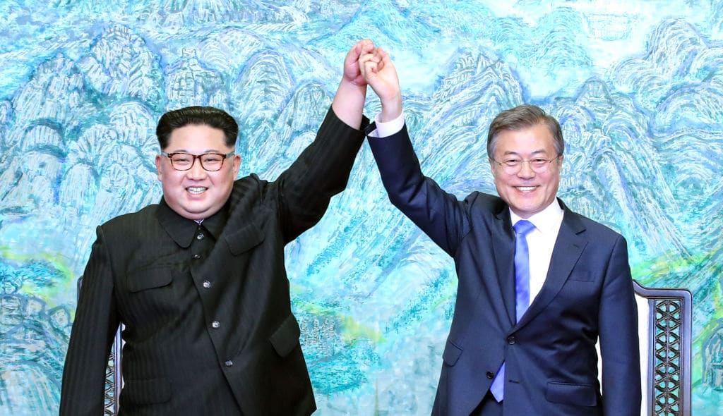 North Korean leader Kim Jong Un (L) and South Korean President Moon Jae-in (R) pose for photographs after signing the Panmunjom Declaration for Peace, Prosperity and Unification of the Korean Peninsula during the Inter-Korean Summit at the Peace House on April 27, 2018 in Panmunjom, South Korea. (Photo by Korea Summit Press Pool/Getty Images)