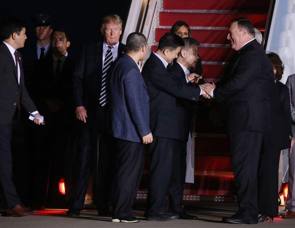 Secretary of State Mike Pompeo (R), greets three Americans just released from North Korea, Kim Dong Chul, Kim Hak-song and Tony Kim, as President Donald Trump stands nearby, at Joint Base Andrews on May 9, 2018 in Maryland.  (Photo by Mark Wilson/Getty Images)