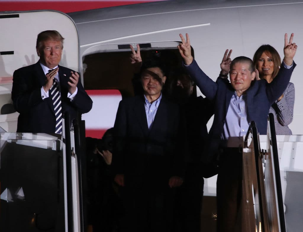 U.S. President Donald Trump applauds the three Americans just released from North Korea, Kim Dong Chul, Kim Hak-song and Tony Kim at Joint Base Andrews on May 9, 2018 in Maryland. Secretary of State Mike Pompeo traveled to North Korea and returned with the three men who have been detained in North Korea. (Photo by Mark Wilson/Getty Images)