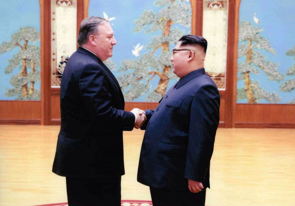 In this handout provided by The White House, CIA director Mike Pompeo (L) shakes hands with North Korean leader Kim Jong Un in this undated image in Pyongyang, North Korea. Pompeo, now confirmed as Secretary of State, spoke with Kim for more than an hour during a secret visit over the Easter weekend. (Photo by The White House via Getty Images)