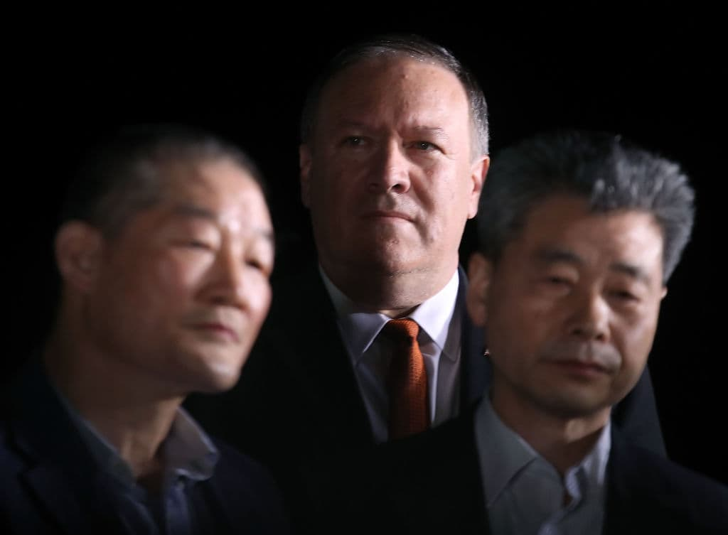 Secretary of State Mike Pompeo stands with two Americans just released from North Korea, Kim Dong Chul, Kim Hak-song and Tony Kim at Joint Base Andrews on May 9, 2018 in Maryland. (Photo by Mark Wilson/Getty Images)