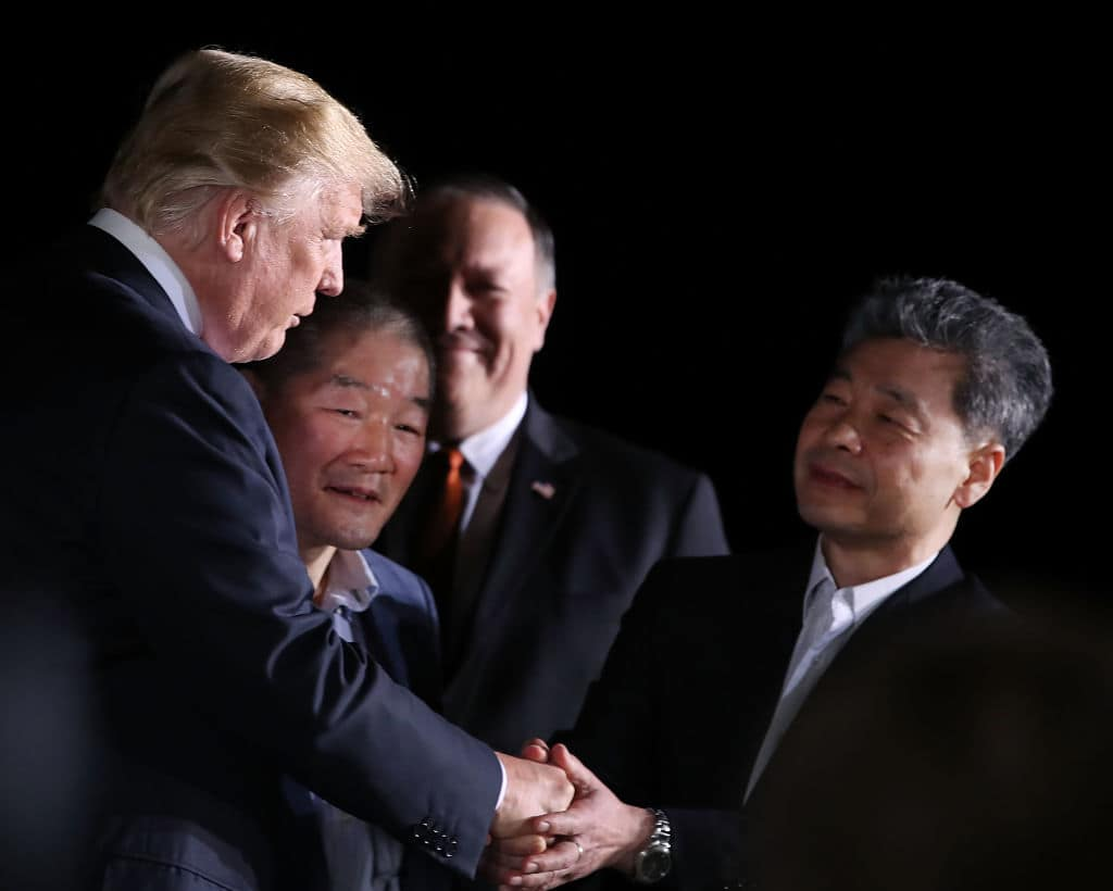 U.S. President Donald Trump stands with Americans just released from North Korea, Kim Dong Chul, Kim Hak-song and Tony Kim, as Secretary of State Mike Pompeo stands nearby, at Joint Base Andrews on May 9, 2018 in Maryland. Secretary of State Mike Pompeo traveled to North Korea and returned with the three men who had been detained for up to two years. The three U.S. citizens have been released as a goodwill gesture ahead of a planned summit between Trump and Kim Jong Un.(Photo by Mark Wilson/Getty Images). (Photo by Mark Wilson/Getty Images)