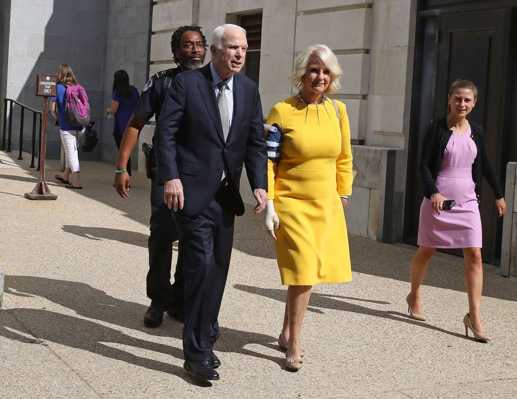 Sen. John McCain (R-AZ) and his wife Cindy McCain walk out of the Russell Senate Office building toward their car at the US Capitol July 25, 2017 in Washington, DC. (Getty Images)