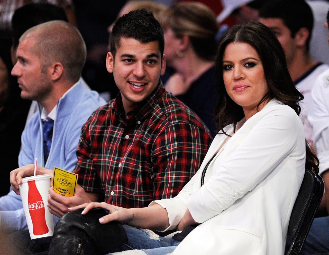 Khloe Kardashian wife of Los Angeles Lakers Lamar Odom #7 and her brother Rob Kardashian follow the action during the NBA basketball game against Atlanta Hawks at Staples Center on November 1, 2009 in Los Angeles, California. (Photo by Kevork Djansezian/Getty Images)