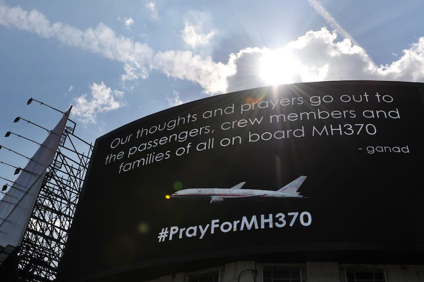 An electronic billboard displays a message about the missing Malaysian Airlines flight MH370 on March 23, 2014 in Kuala Lumpur, Malaysia. (Getty Images)