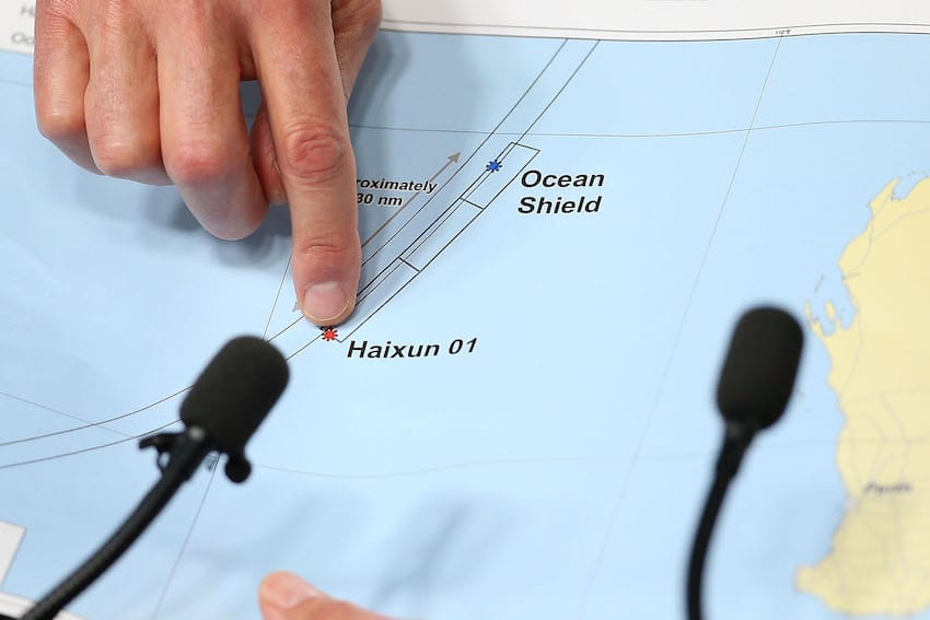 Air Chief Marshal Angus Houston (ret'd) holds a map outlining the current search areas of naval ships Ocean Shield and Haixun 01 during a press conference for the continuing search of missing Malaysia Airlines Flight MH370 at Dumas House on April 7, 2014 in Perth, Australia. (Getty Images)