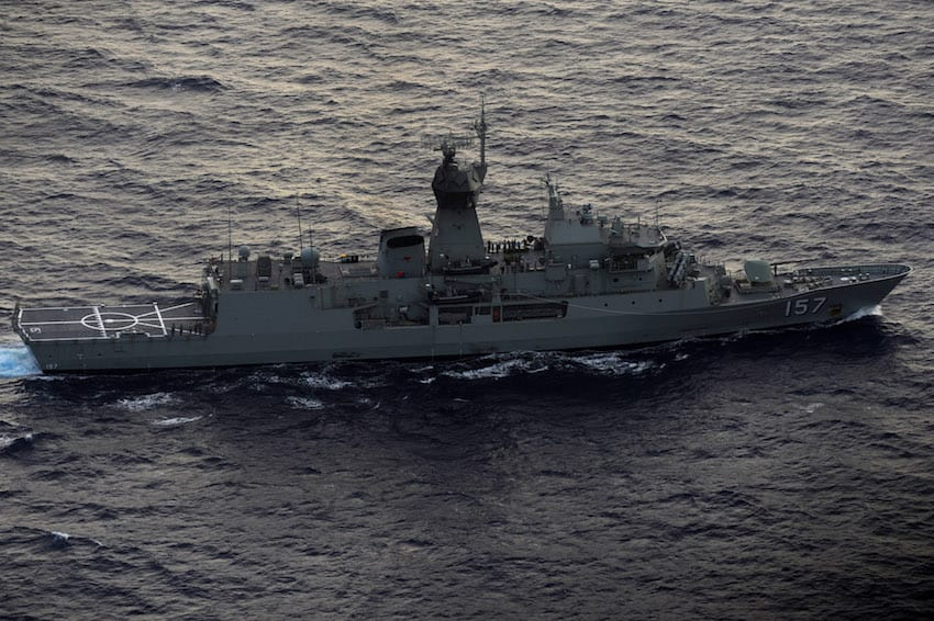 Seen from the Royal New Zealand Airforce (RNZAF) P-3K2-Orion aircraft, the Australian ship HMAS Perth is guided into position by the RNZAF aircraft to recover a red object during the search for missing Malaysia Airlines flight MH370 in flight over the Indian Ocean on April 13, 2014. (Getty Images)