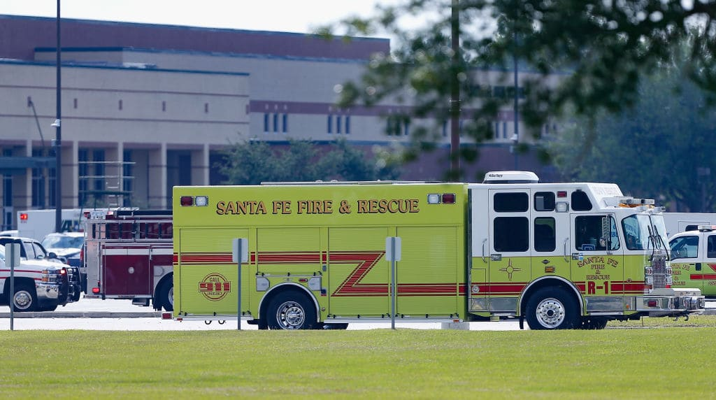 Emergency crews stage in the parking lot of Santa Fe High School where at least 10 students were killed on May 18, 2018 in Santa Fe, Texas (Photo by Bob Levey/Getty Images)