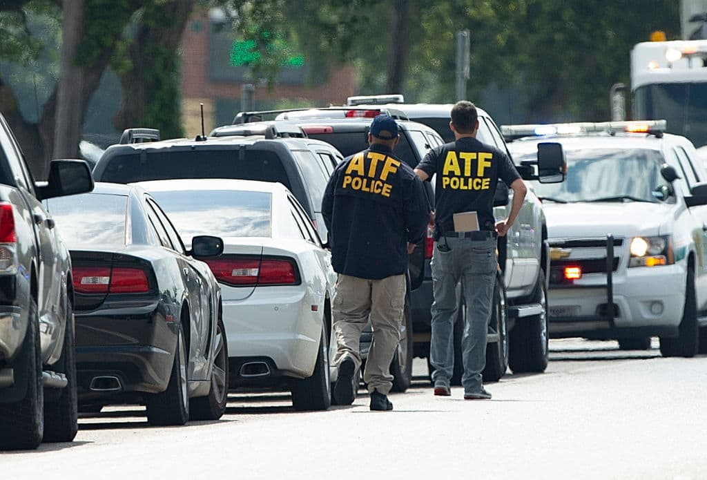 ATF agents arrive on location at Santa Fe High School where a shooter killed at least 10 students on May 18, 2018, in Santa Fe, Texas. At least 10 people were killed when a gunman opened fire at Santa Fe High school. Police arrested a student suspect and detained a second person. (Photo by Bob Levey/Getty Images)