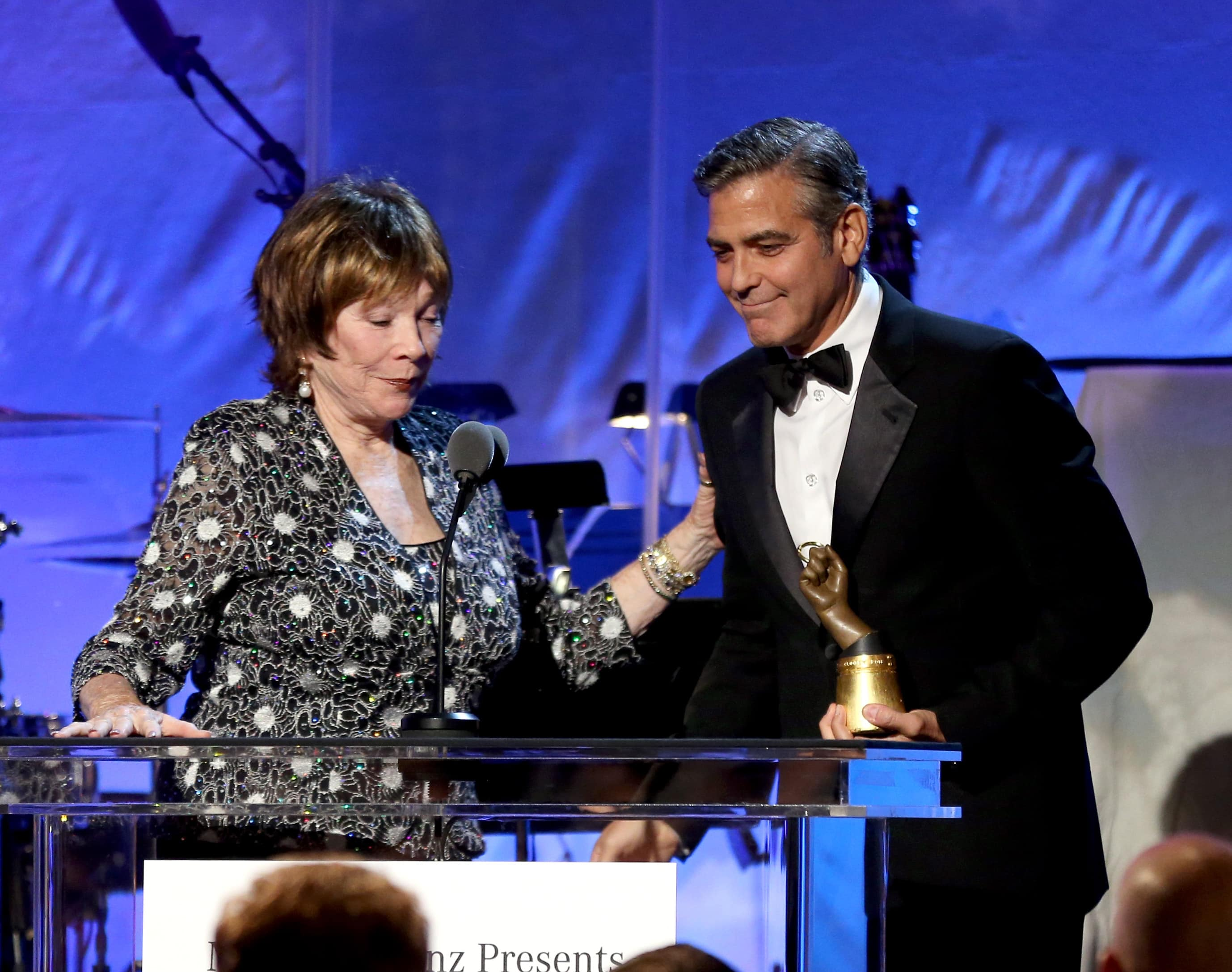 Actress Shirley MacLaine presents the Brass Ring Award to actor/honoree George Clooney onstage during the 26th Anniversary Carousel Of Hope Ball presented by Mercedes-Benz at The Beverly Hilton Hotel on October 20, 2012, in Beverly Hills, California. (Photo by Christopher Polk/Getty Images)