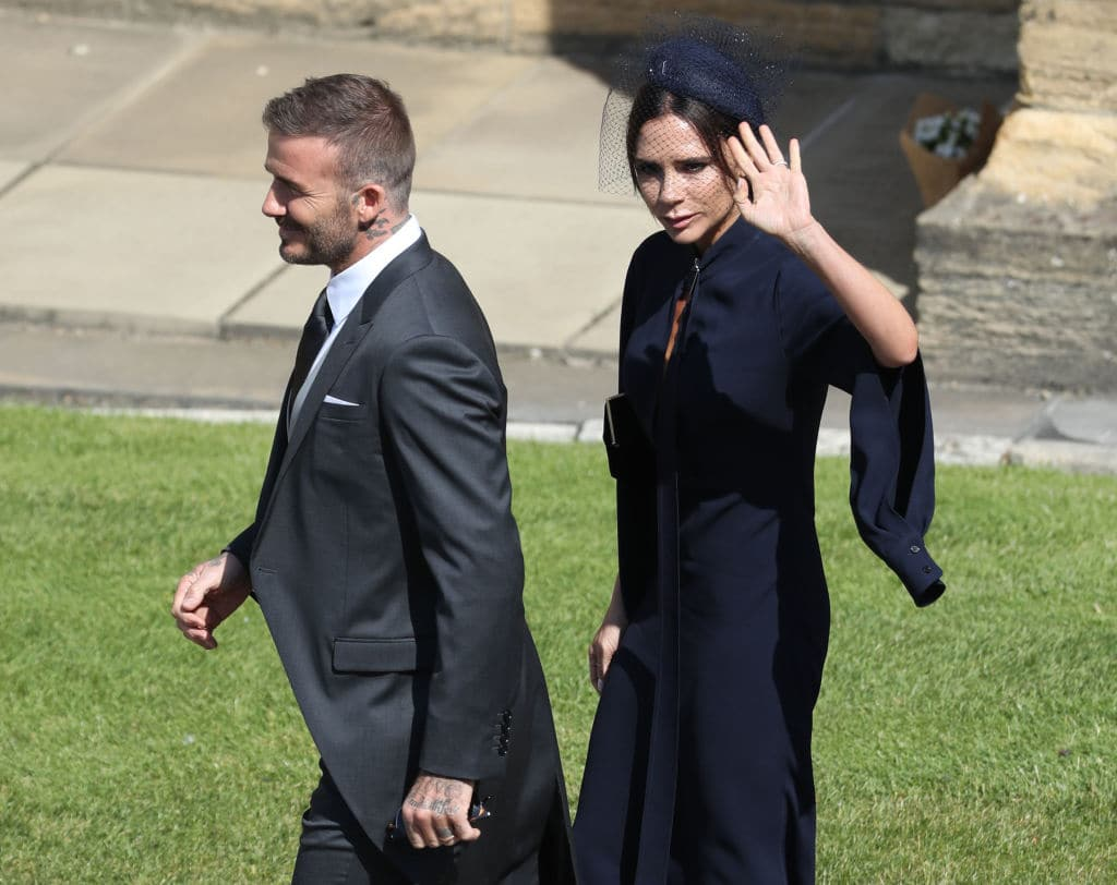 David and Victoria Beckham arrive at St George's Chapel, Windsor Castle for the wedding of Megan Markle and Prince Harry at St George's Chapel, Windsor Castle on May 19, 2018 (Photo by Andrew Milligan - WPA Pool/Getty Images)
