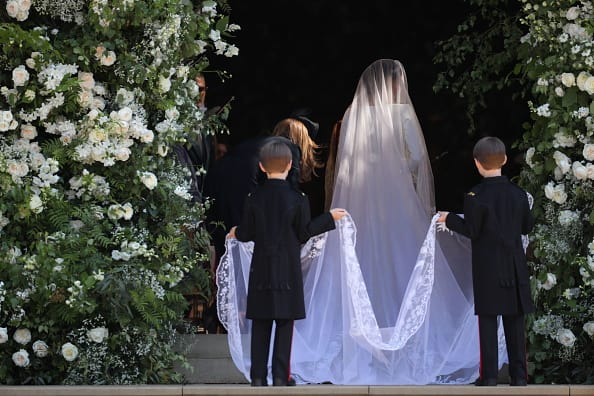 Made from silk threads and organza, the veil is five meters long and had to be held by two pageboys as Markle arrived. (Getty Images)