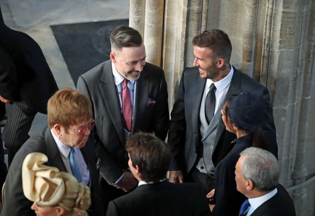 Elton and his husband David Furnish were greeting the Beckhamswhen he pecked David Beckhamon the lips (GettyImages)