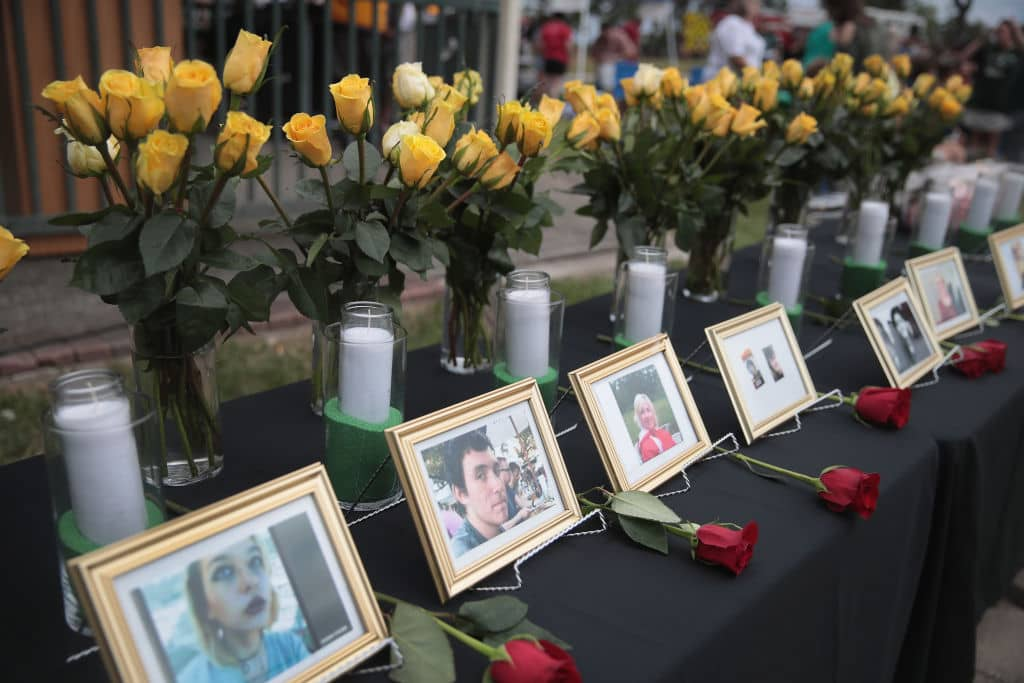 Pictures of victims of the Santa Fe High School shooting are displayed during a prayer vigil at Walter Hall Park on May 20, 2018 in League City, Texas. (Photo by Scott Olson/Getty Images)