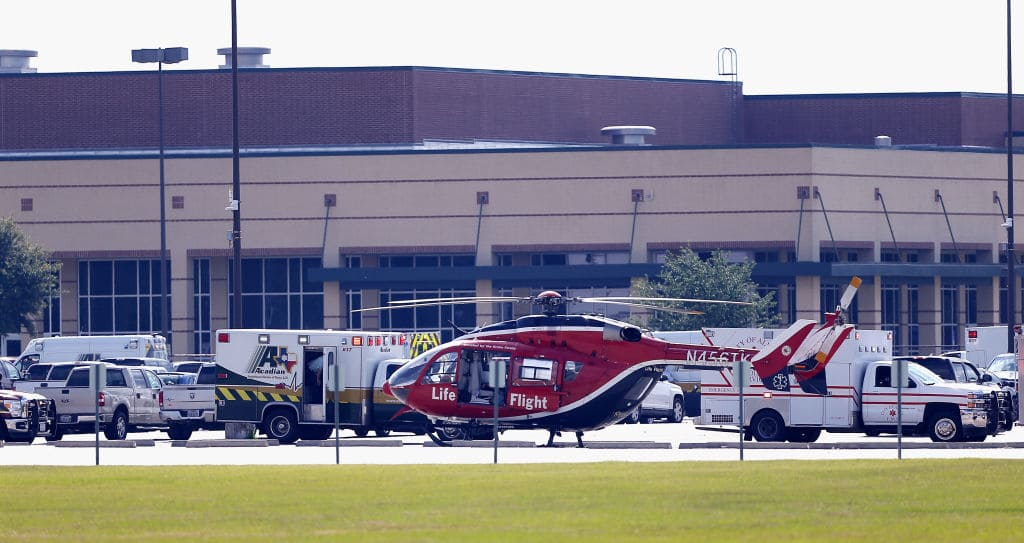 Emergency crews stage in the parking lot of Santa Fe High School where at least 10 students were killed on May 18, 2018 in Santa Fe, Texas. (Photo by Bob Levey/Getty Images)