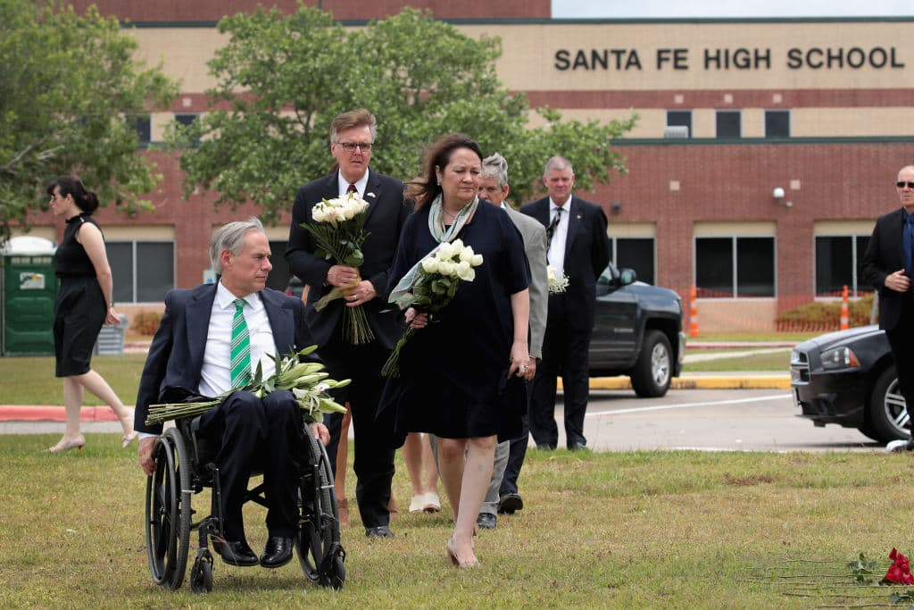 Texas Governor Greg Abbott visits Santa Fe High School with his wife Cecilia to lay flowers at a small memorial on May 20, 2018 in Santa Fe, Texas. (Photo by Scott Olson/Getty Images)
