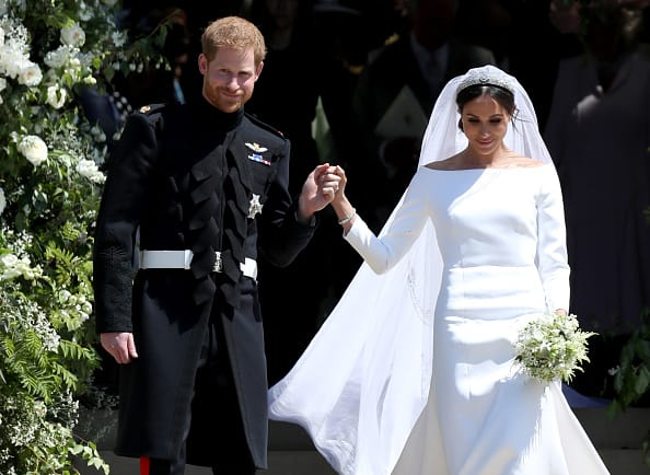 The Duke and Duchess of Sussex step out to acknowledge the public gathered at their wedding on May 19 (Source: Getty Images)