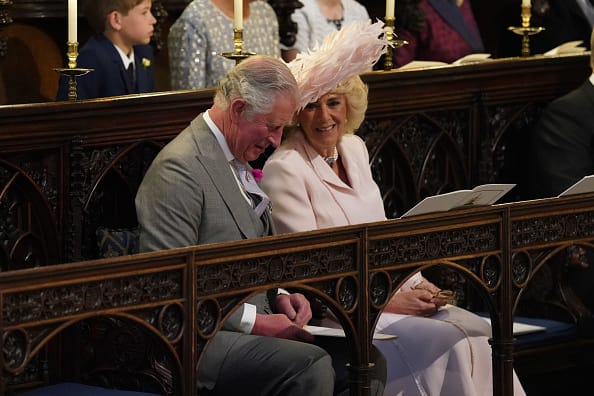 Prince Charles and Camilla Parker Bowles share a smile in St George's Chapel moments before Prince Harry wed Meghan Markle on May 19 (Source: Getty Images)