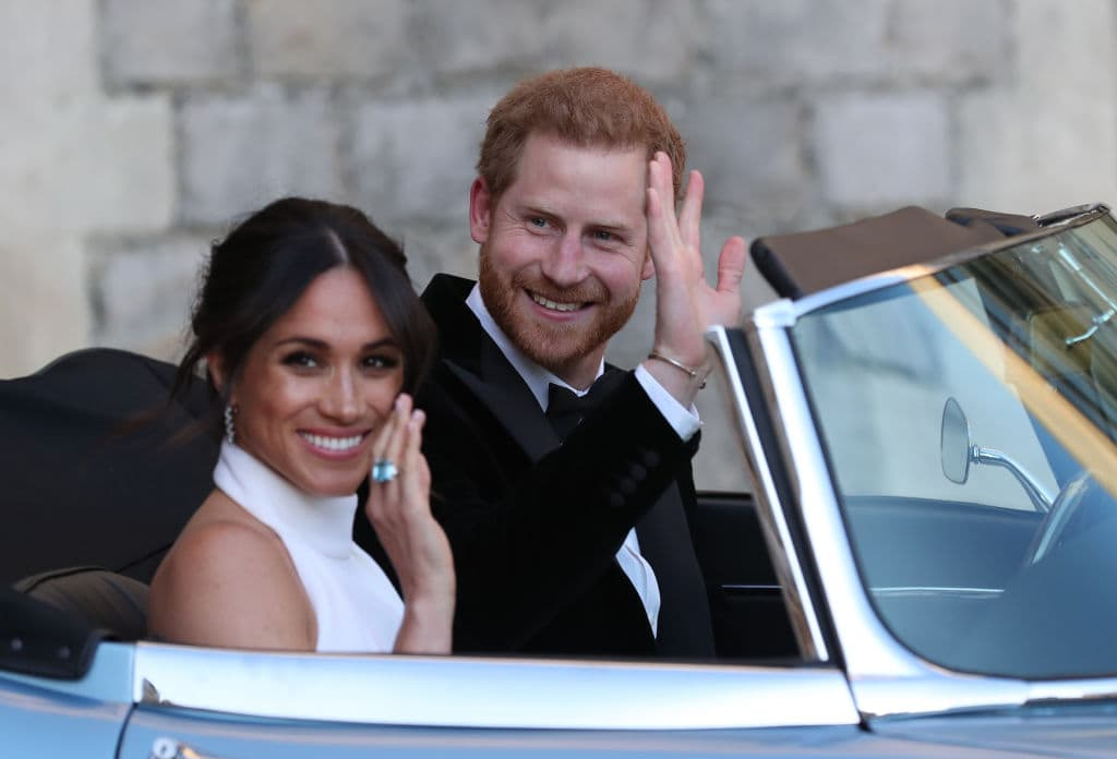 Duchess of Sussex and Prince Harry, Duke of Sussex wave as they leave Windsor Castle after their wedding to attend an evening reception at Frogmore House, hosted by the Prince of Wales on May 19, 2018 in Windsor, England. (Photo by Steve Parsons - WPA Pool/Getty Images)