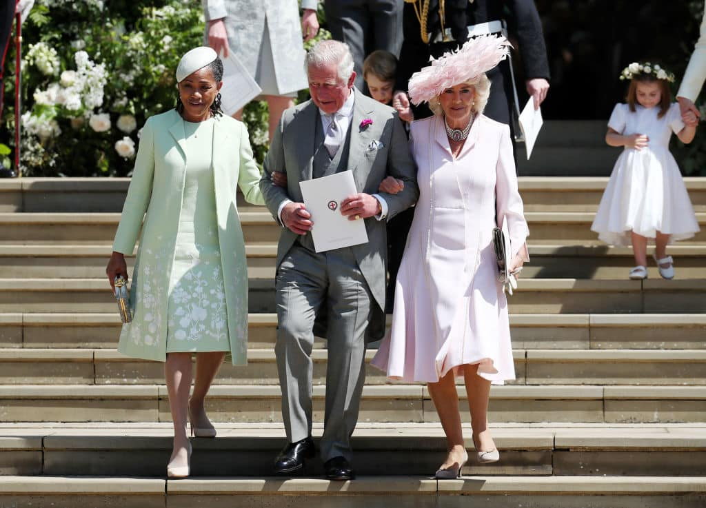 Doria Ragland, mother of the bride, Prince Charles, Prince of Wales and Camilla, Duchess of Cornwall walk down the steps at Windsor Castle after the wedding of Prince Harry and Meghan Markle on May 19, 2018 in Windsor, England. (Photo by Jane Barlow - WPA Pool/Getty Images)