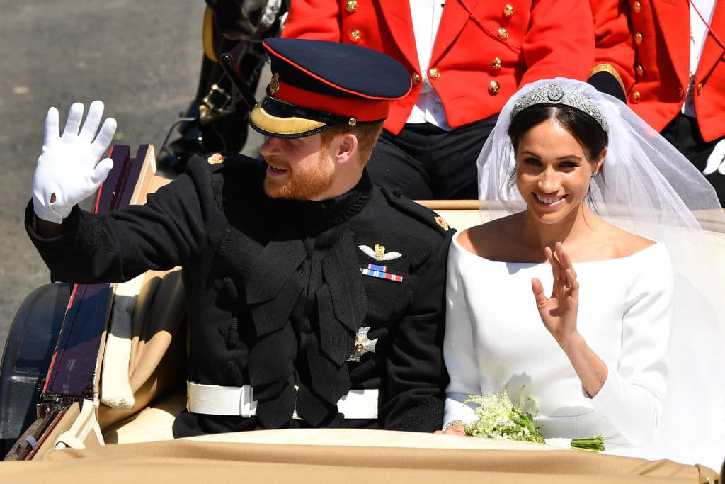 Prince Harry, Duke of Sussex and Meghan, Duchess of Sussex leave Windsor Castle in the Ascot Landau carriage during a procession after getting married at St Georges Chapel on May 19, 2018 in Windsor, England. (Photo by Leon Neal/Getty Images)