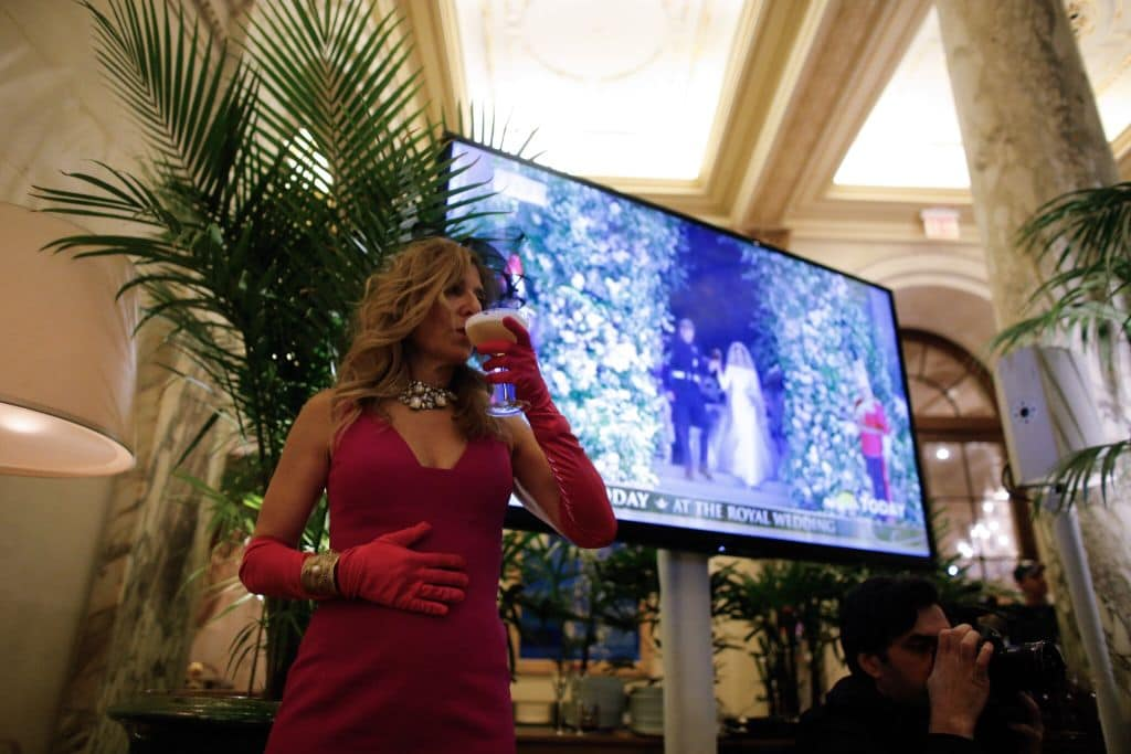 Royal wedding theme parties were held in many cities. Here a New Yorker toasts Harry and Meghan (Getty Images)