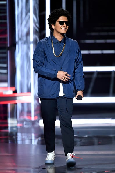 Recording artist Bruno Mars speaks onstage during the 2018 Billboard Music Awards at MGM Grand Garden Arena on May 20, 2018 in Las Vegas, Nevada. (Photo by Kevin Winter/Getty Images)