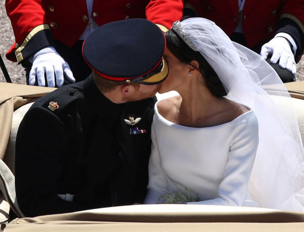 The couple stole a quick kiss in the carriage and Mok managed to catch that as well (Getty Images)