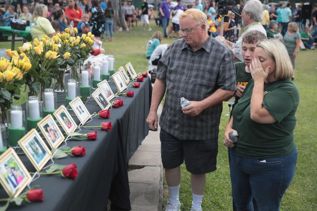 Pictures of victims of the Santa Fe High School shooting are displayed during a prayer vigil at Walter Hall Park on May 20, 2018 in League City, Texas (Getty Images)