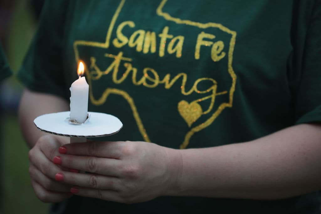 Residents attend a prayer vigil to remember the victims from the Santa Fe High School shooting at Walter Hall Park on May 20, 2018 in League City, Texas (Getty Images)
