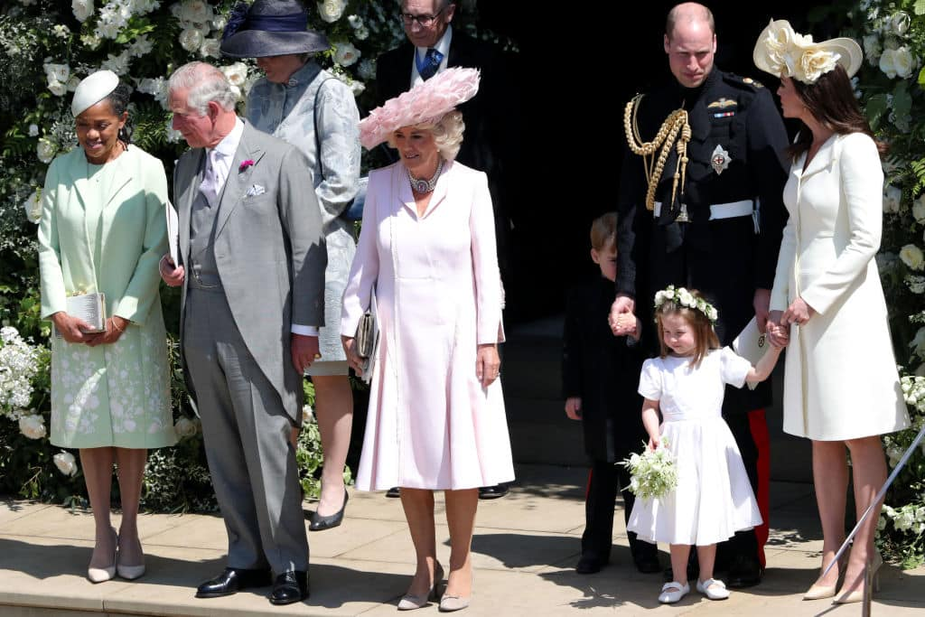 Doria Ragland, Prince Charles, Prince of Wales, Camilla, Duchess of Cornwall Prince William, Duke of Cambridge, Catherine, Duchess of Cambridge with Prince George and Princess Charlotte leave St George's Chapel in Windsor Castle after the wedding on May 19, 2018 in Windsor, England. (Photo by Andrew Matthews - WPA/Getty Images)
