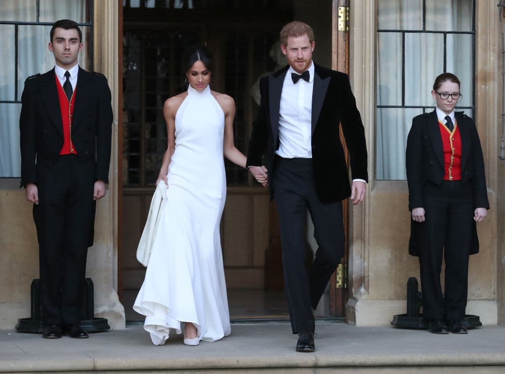 Duchess of Sussex and Prince Harry, Duke of Sussex leave Windsor Castle after their wedding to attend an evening reception at Frogmore House, hosted by the Prince of Wales on May 19, 2018 in Windsor, England. (Photo by Steve Parsons - WPA Pool/Getty Images)